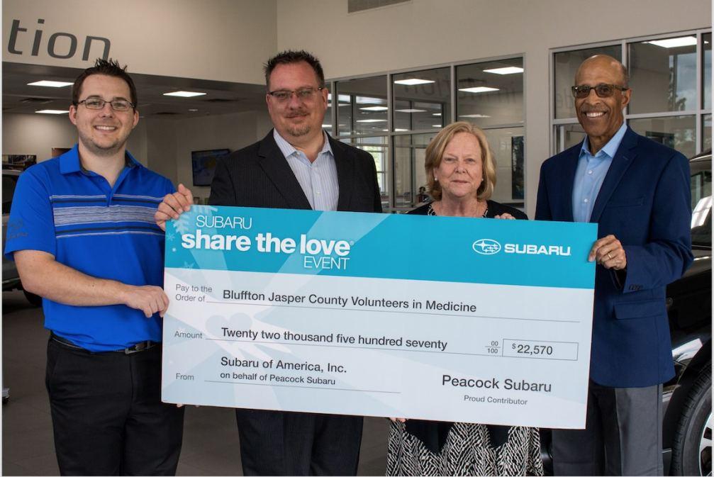 Peacock Subaru Presents Check to Volunteers in Med