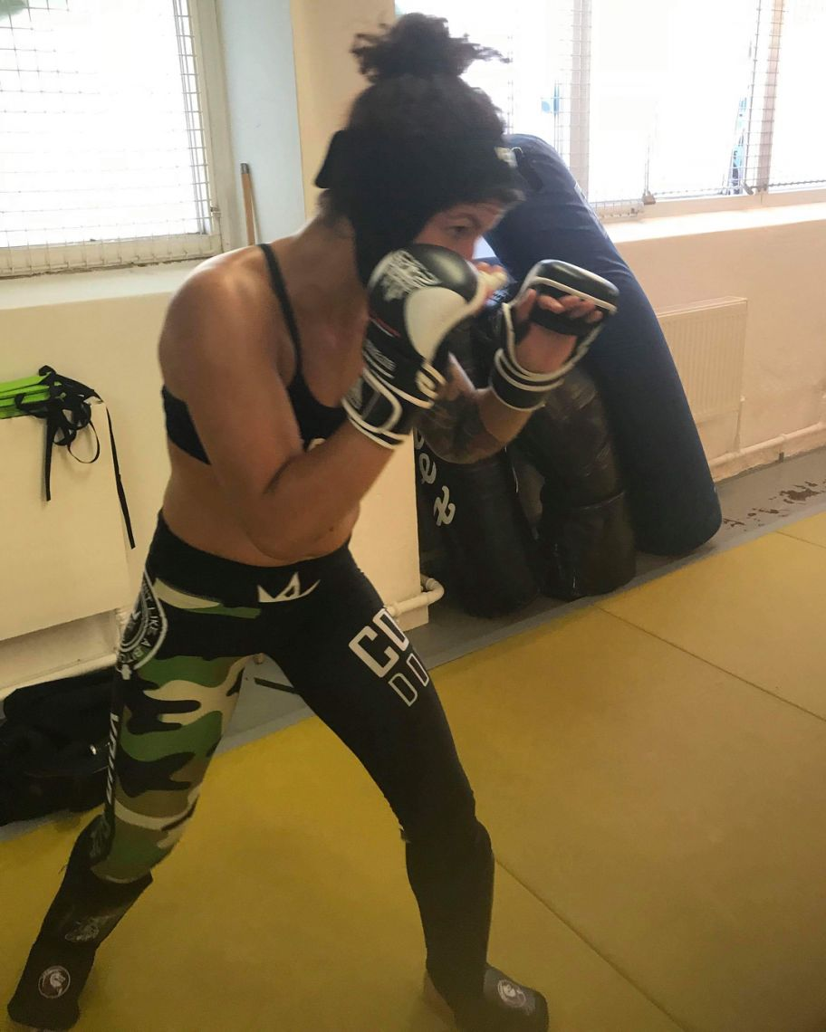 Pannie Kianzad training for The Ultimate Fighter in her Combat Dollies apparel