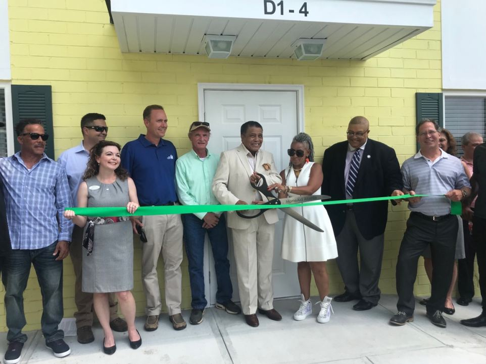 Cutting the ribbon at Making A Way Housing on July 19, 2018.
