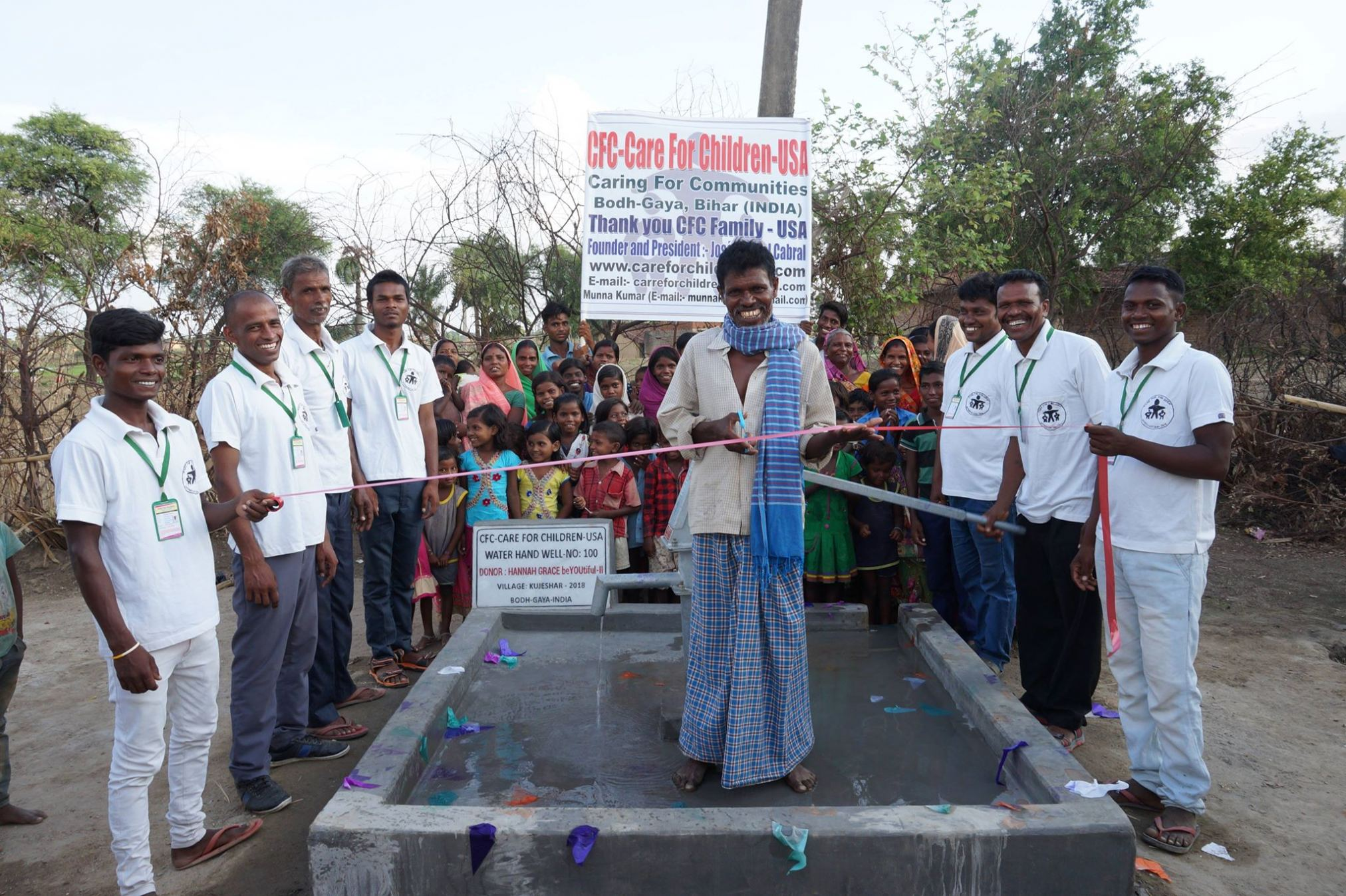 Care For Children International team members and villagers inaugurate 100th well