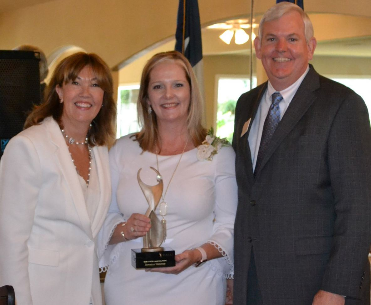 Danielle Scheiner, with Cathy Nash and George Waggoner, holds first ATHENA Award