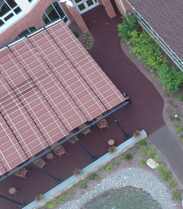 Overhead view of the red Porous Pave patio and transition to the tan paths