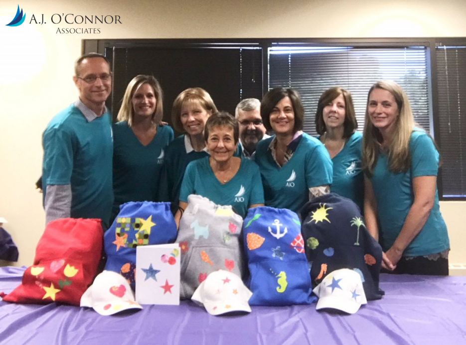 The AJO Team donates Backpack Bundles to Immigrant Children in the care of LSSNY