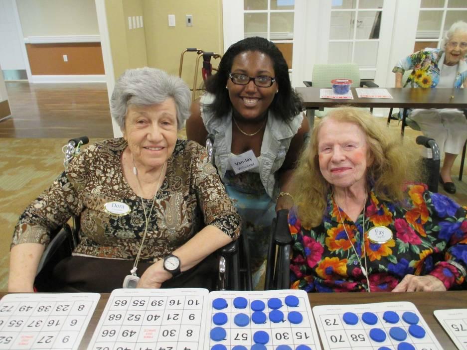 Volunteer Van-Jay Haughton with residents Dora Coronato and Fay Targrove