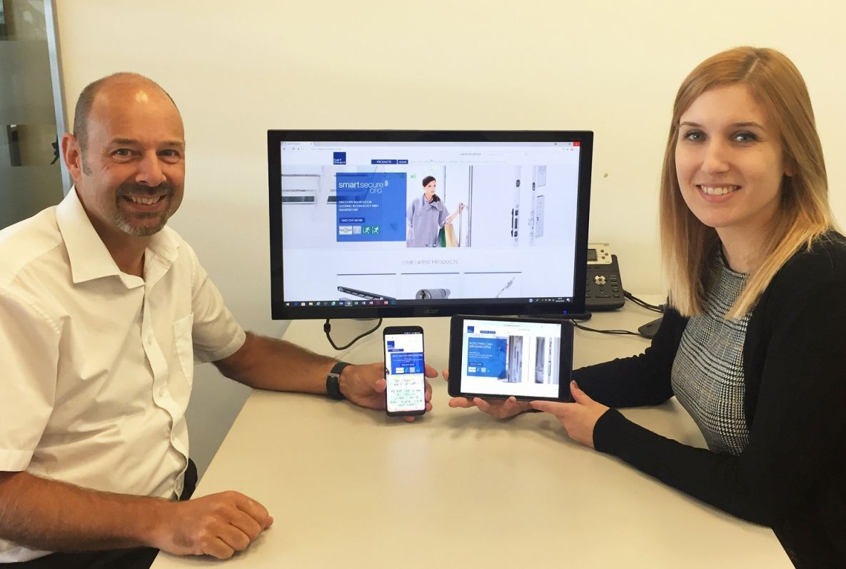 Carl F Groupco's IT Manager and Marketing Manager display the new website