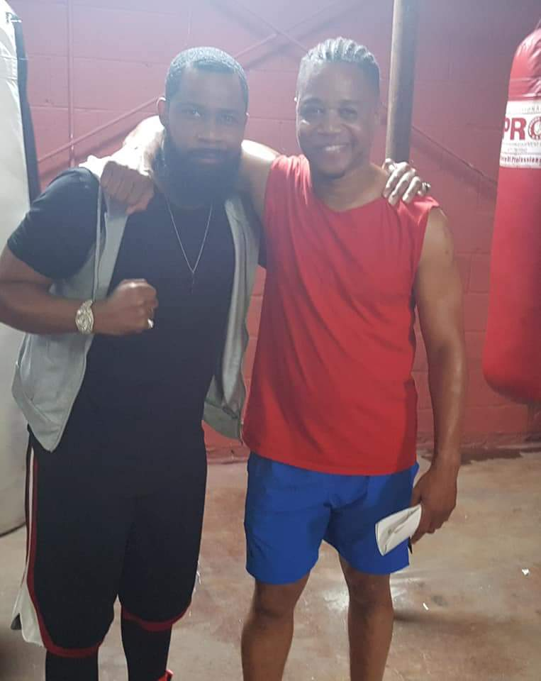 Actors Kedrick Brown and Cuba Gooding Jr. on set
