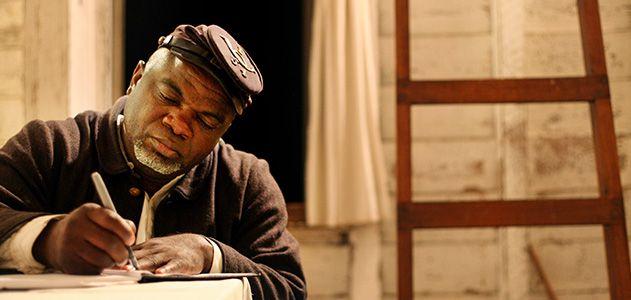 Joe McGill portrayed in civil war slave cabin