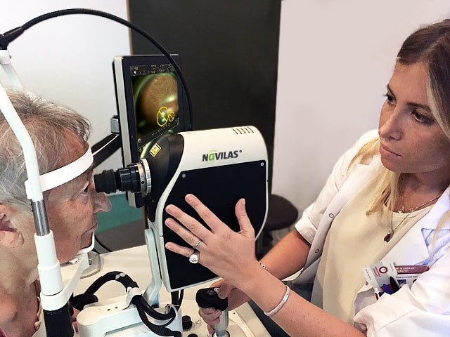 Dr. Amoroso with demonstrator of a new widefield objective for non-contact PRP