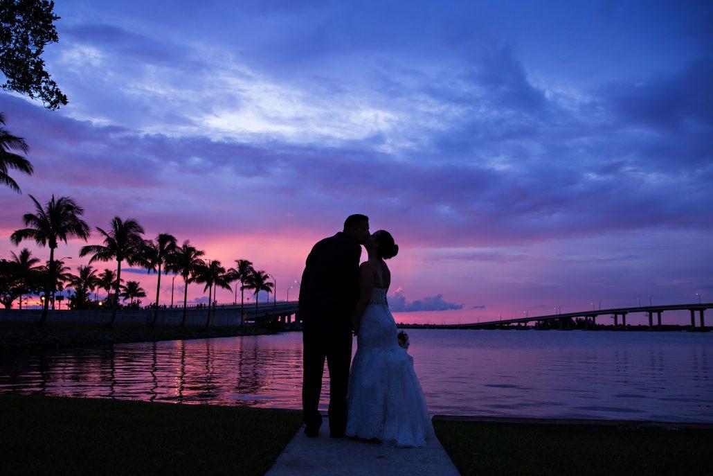 Sunset kiss at water's edge
