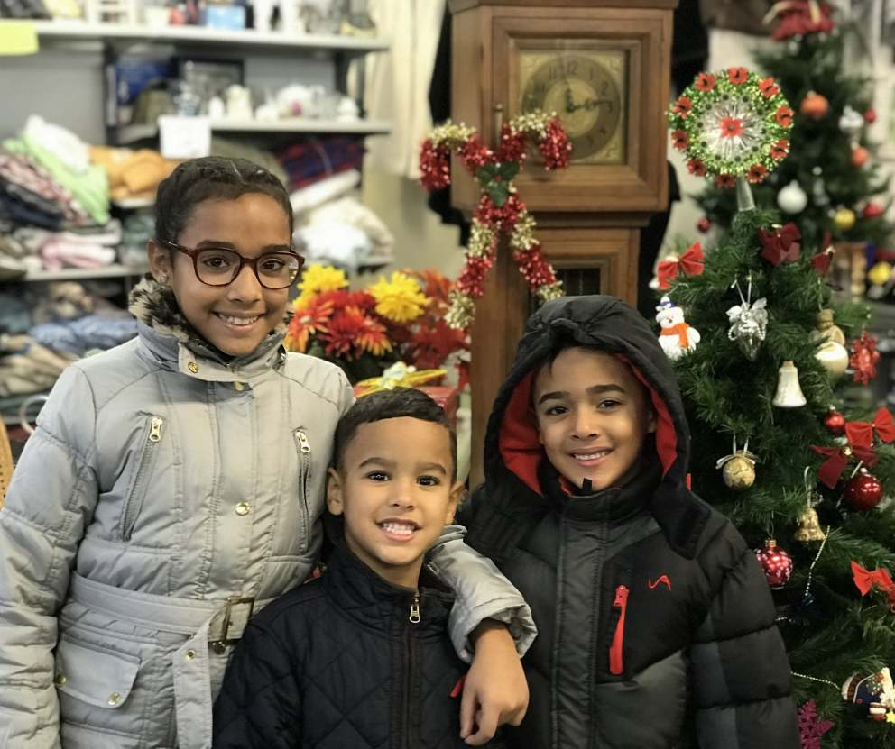 A family displaced by Hurricane Maria in 2017 happily received coats from Acts 4