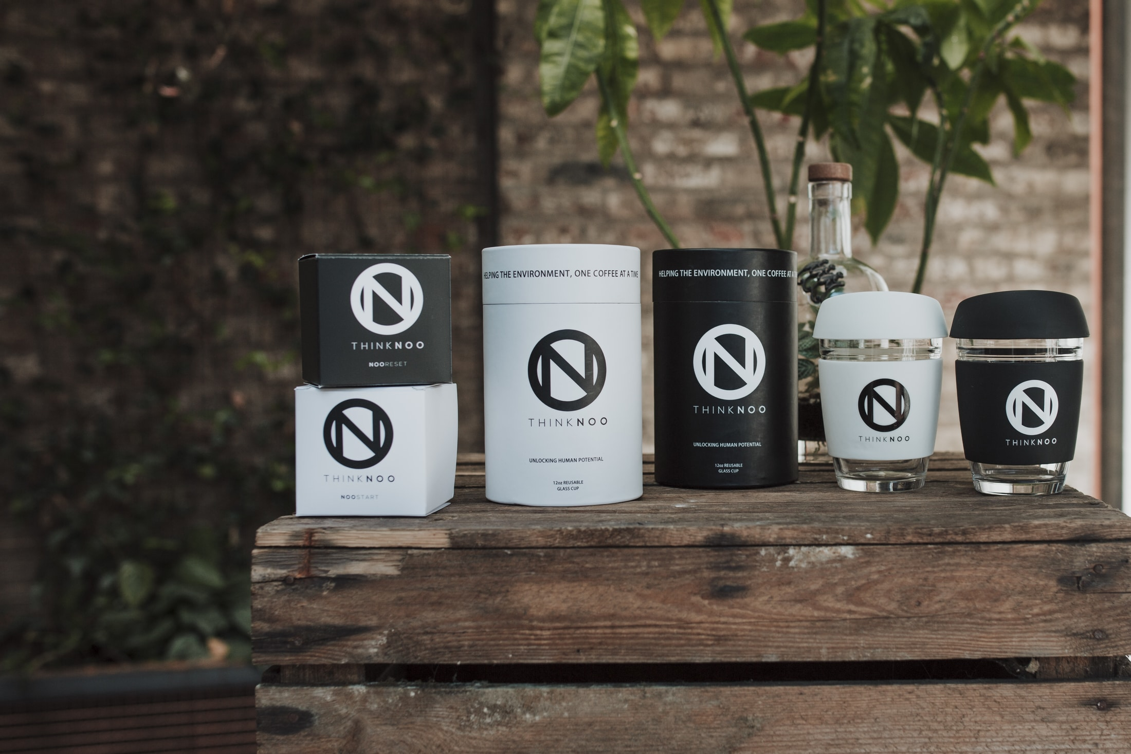 THINKNOO's product range, including their eco-friendly coffee cups: NOOreuse
