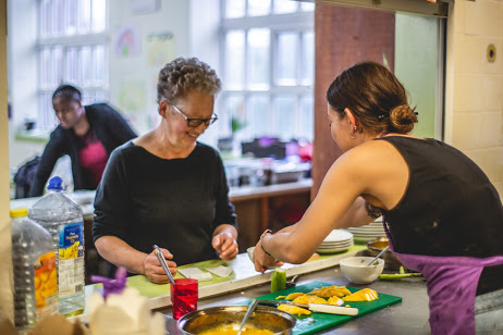 Volunteers preparing food at the pay-as-you-feel cafe