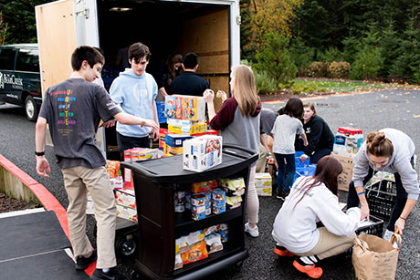 Bear Creek students load food donations in preparation for delivery to Hopelink.