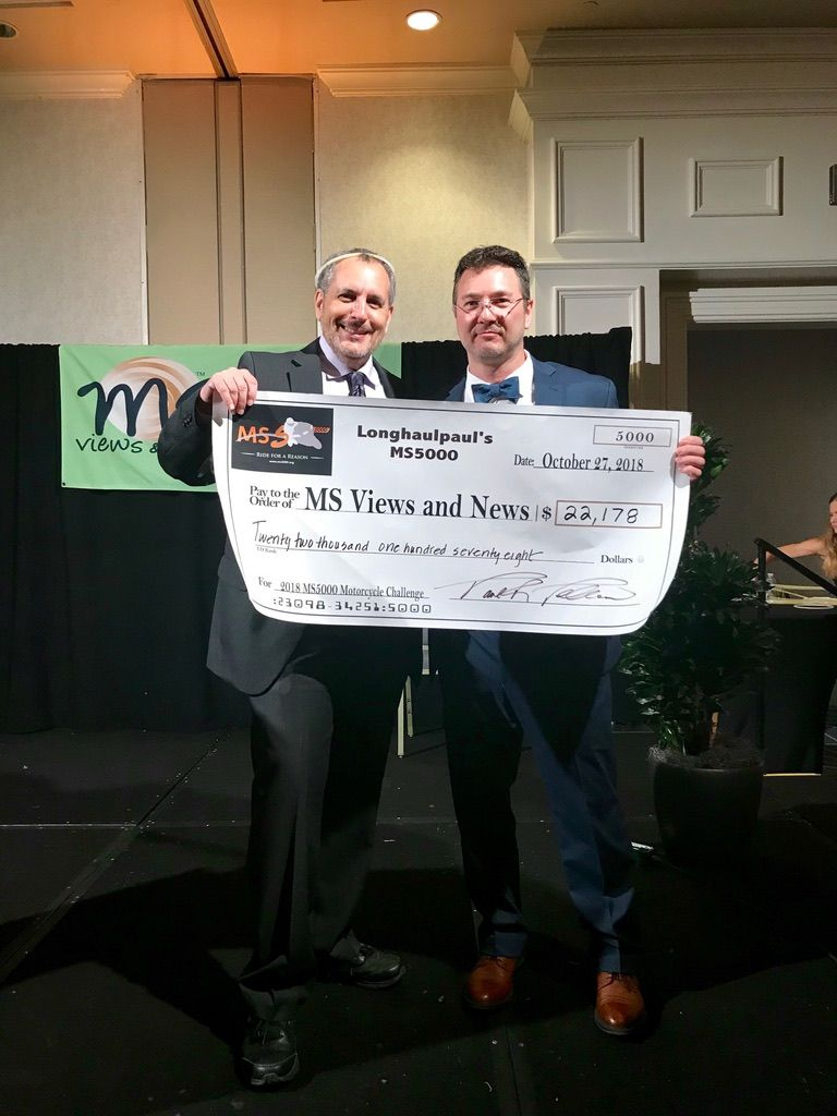 Paul presents Stuart with 2018 MS5000 proceeds