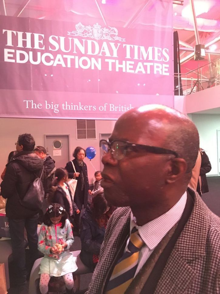 Prof Chris Imafidon assisting parents with schools