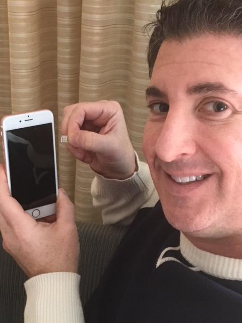 Last Mobile Bill owner Eric Kipperman holding advanced-technology SIM Card