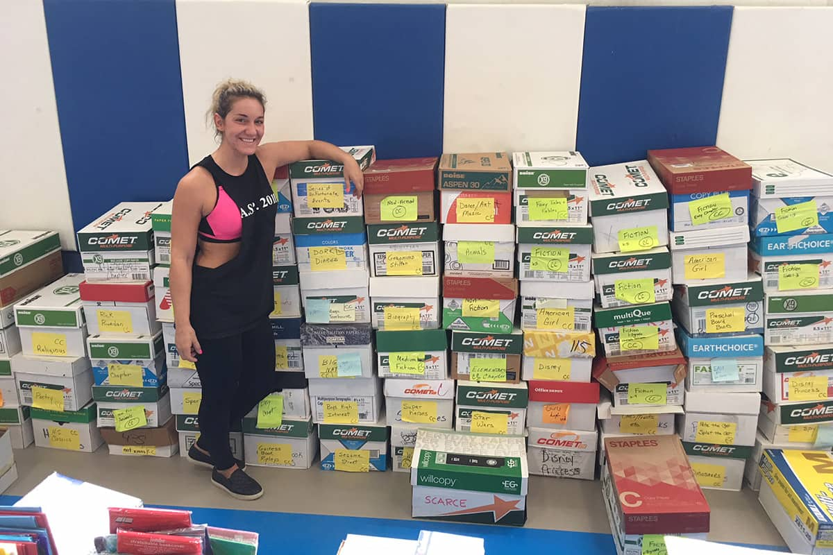 SCARCE Volunteer setting up boxes of books for the book rescue program