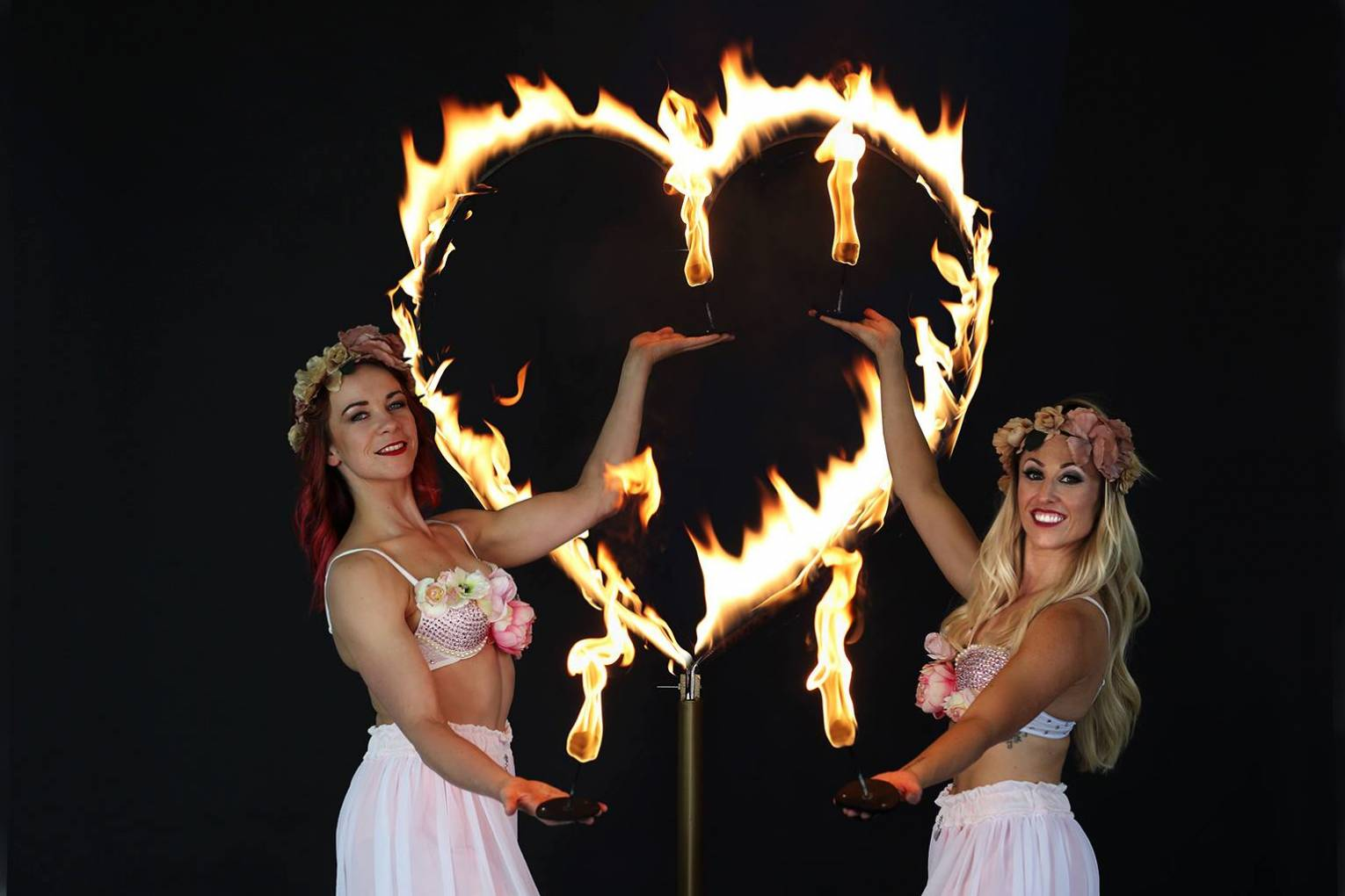 Beautiful fire performers are sure to light up any wedding.