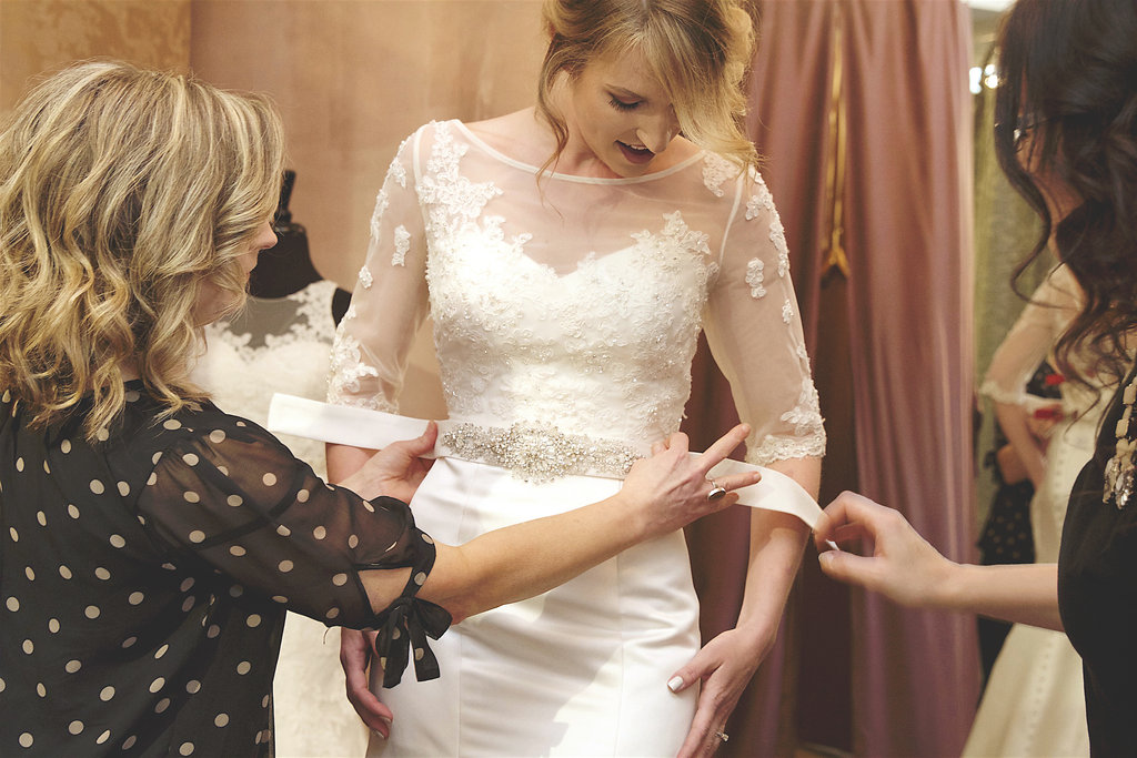 Bride tries on wedding gown at The Wedding Shoppe bridal salon, Berkley, MI