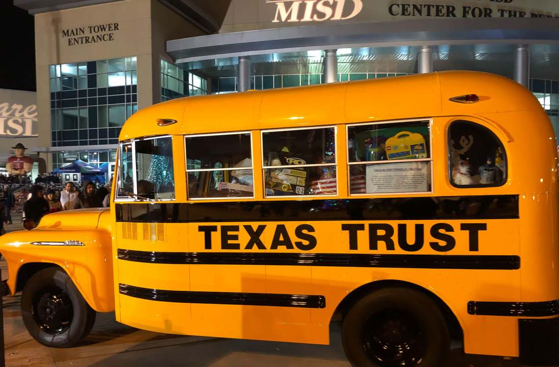 Texas Trust gave $5,000 and a bus load of toys to Toys for Tots