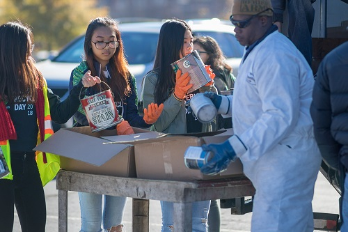 A Group of Student Volunteers Collect Paint During GCB America Recycles Day 2018