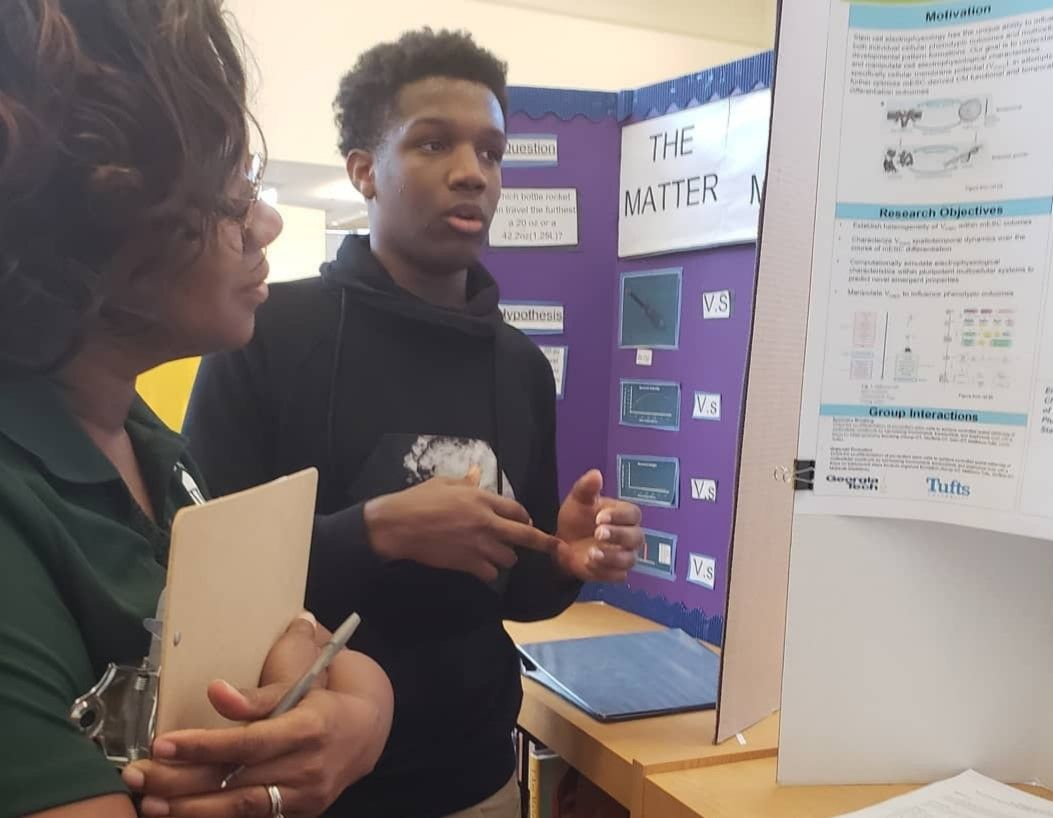 SEM Link Volunteer w/ student at BEST Academy Science Fair