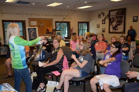 Founder Betty Bauman teaches the art of fishing.