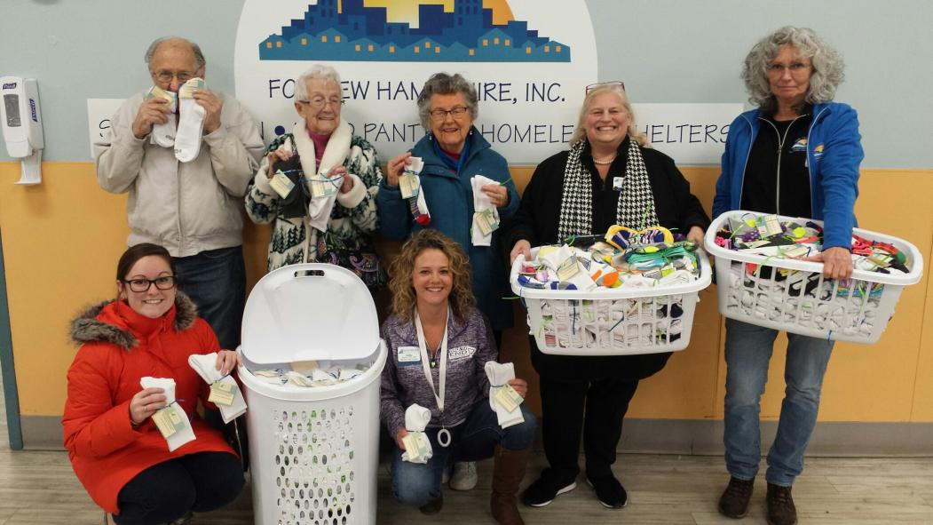 Bedford Falls Donates Over 500 Pairs of Socks to Manchester's Homeless