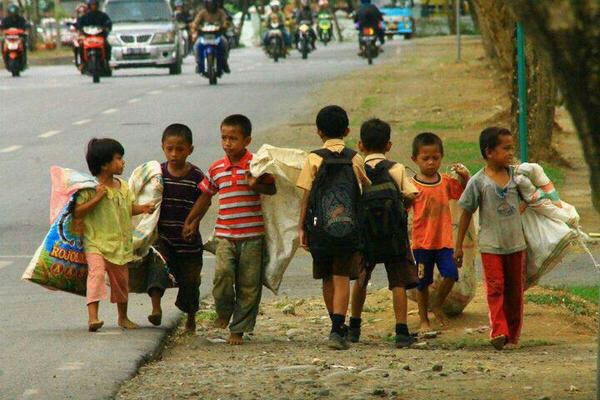 Young children walking to work while others walk to school