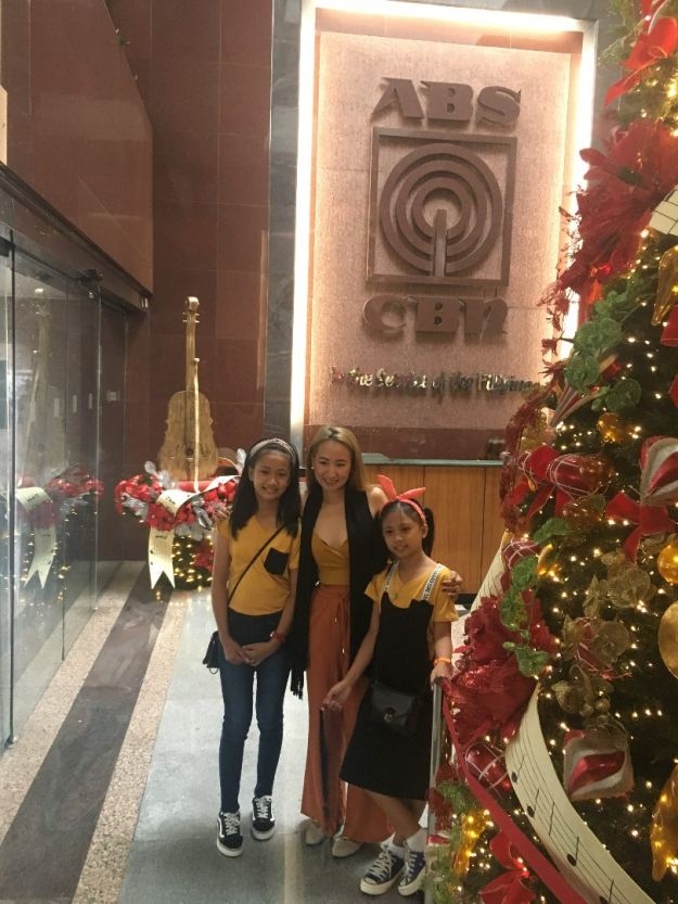 Melodie Duag and her daughters at the ABS-CBN office in Manila.
