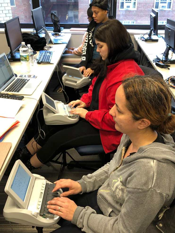 Plaza College students compete for speed and accuracy with their stenotype