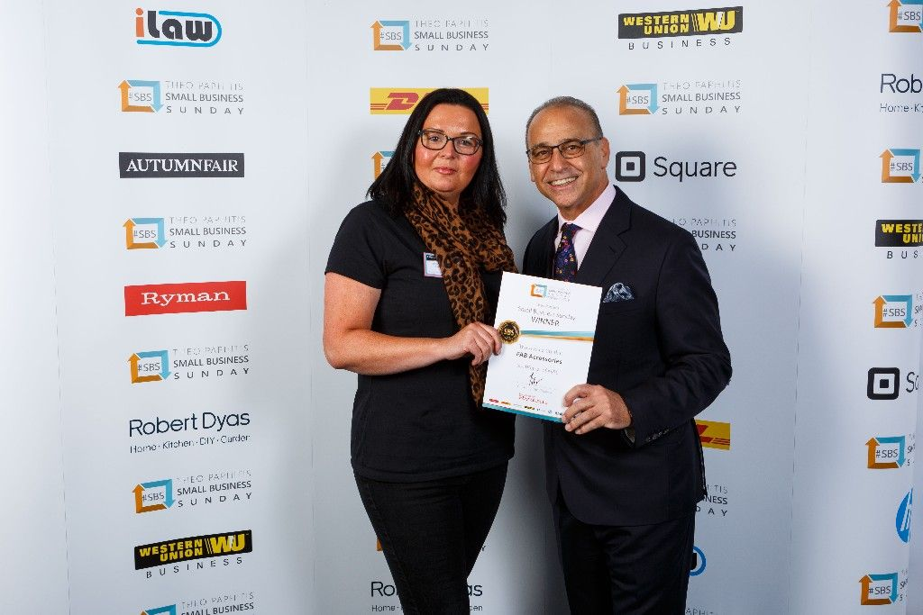 Alison Hitchen receiving her award from Theo Paphitis