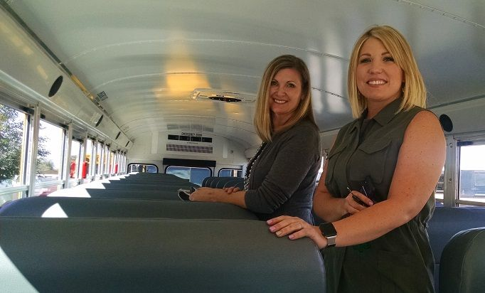 Pat Smith and Chelsea Connolly inspect a new bus.