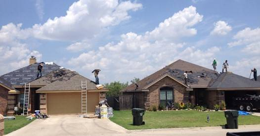 Kingdom Roof and Fence double roofing job in Houst