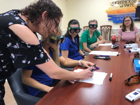 Assistive Technology Specialist Crystle Fliss teaches students