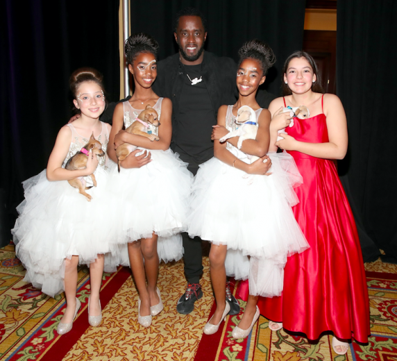 Diddy and daughters, Jessie and D'Lila, & friends at Paw Works Mardi Paws Gala