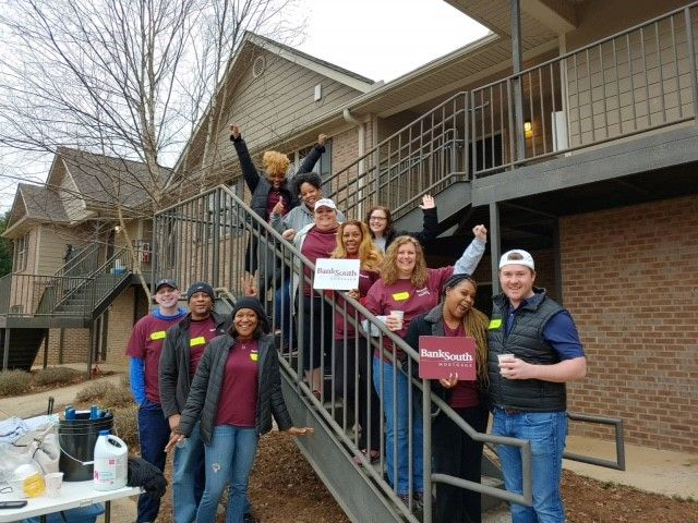 HomeAid volunteers from BankSouth Mortgage at Phoenix Pass on March 8.