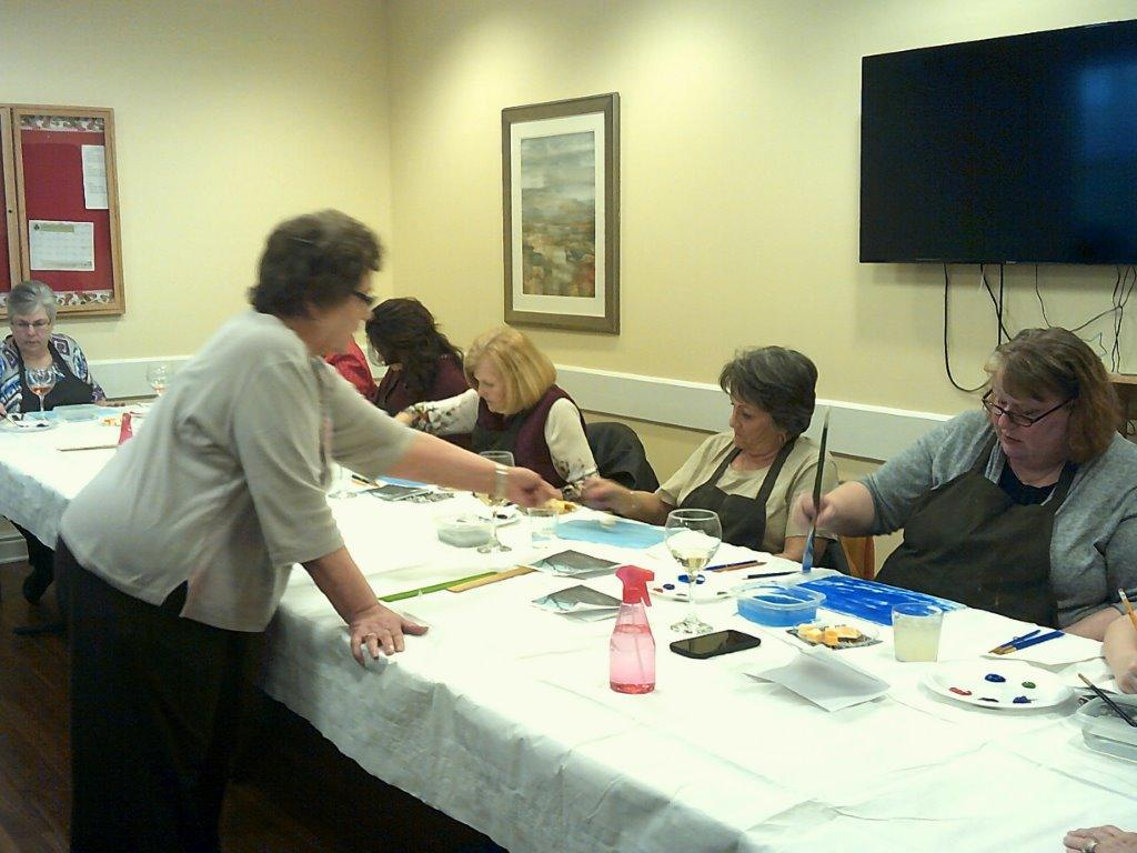 """Clearfield artist Anna Marie Toto works with """"Sip & Paint"""" participants."""