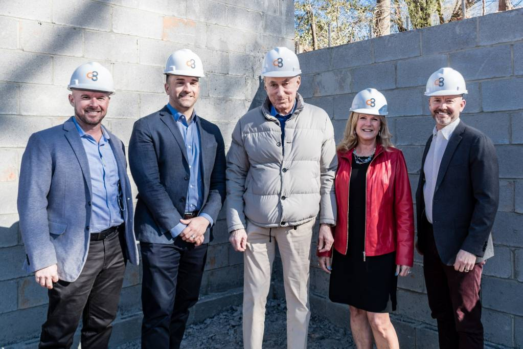 The Clark Townhomes development team gathered at the construction site.