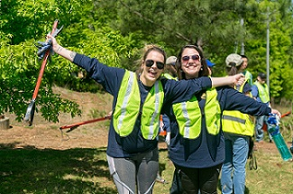 Being Good Stewards of the Environment Brings Smiles to These Volunteers' Faces