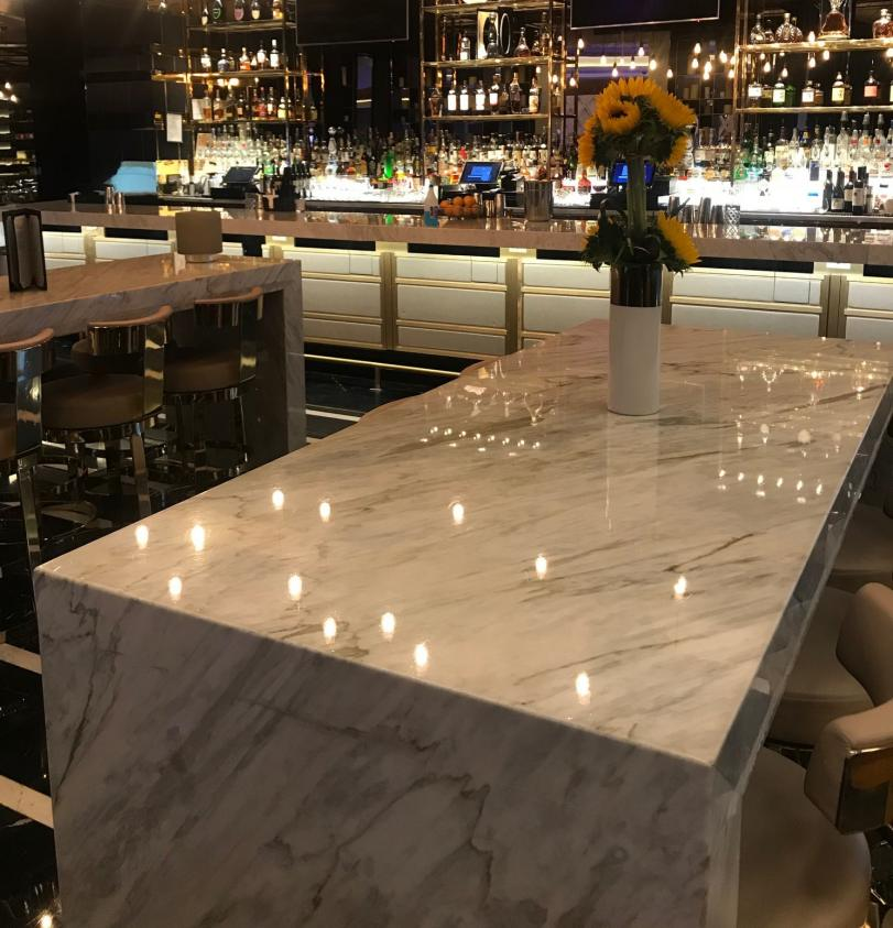 TuffSkin Surface Protection's Original Gloss on restaurant and bar surface.