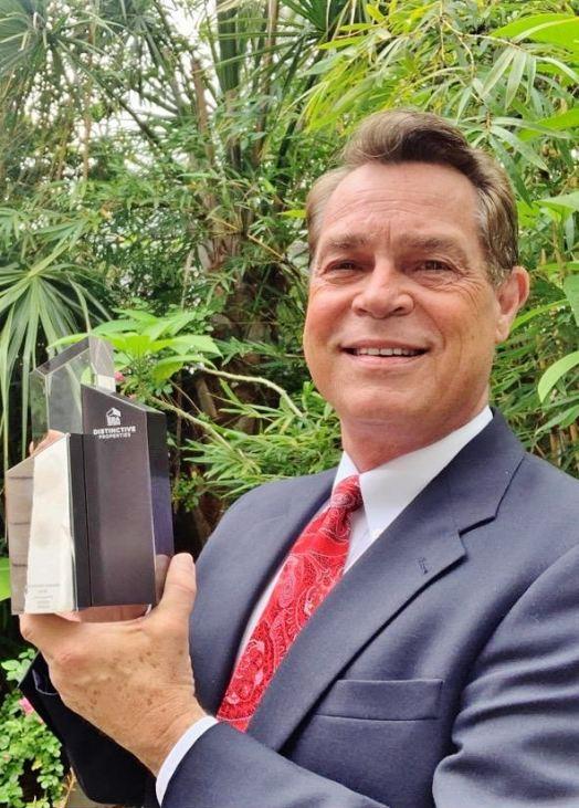 Bobby Shealy holding the award