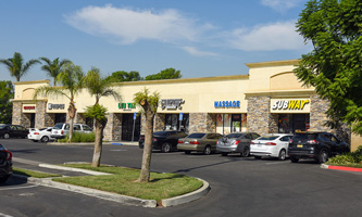 Multi-tenant retail pad building at 2645 E. Riverside Drive in Ontario.