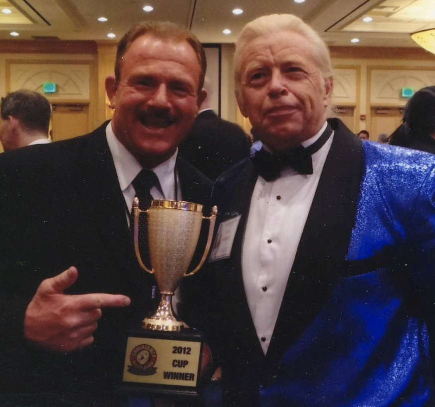 """""""Here Brian Blair is jealously admiring my trophy"""" - Rock Riddle"""