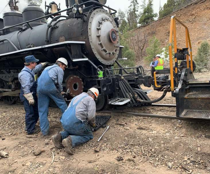 The D&SNGRR roundhouse crew assess the recent damage to Southern Pacific No. 18.