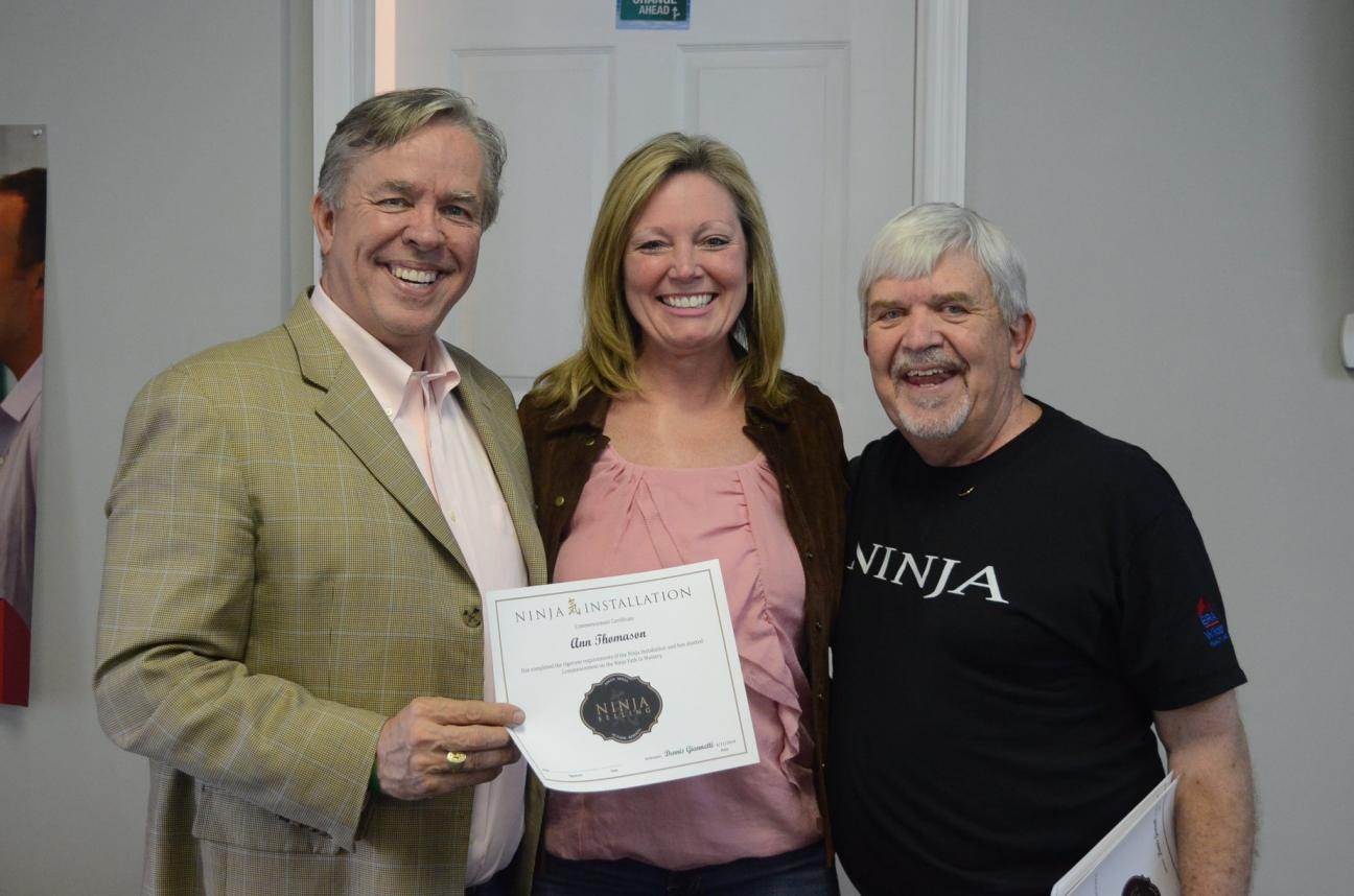 Thomason, center, accepts her NINJA certificate