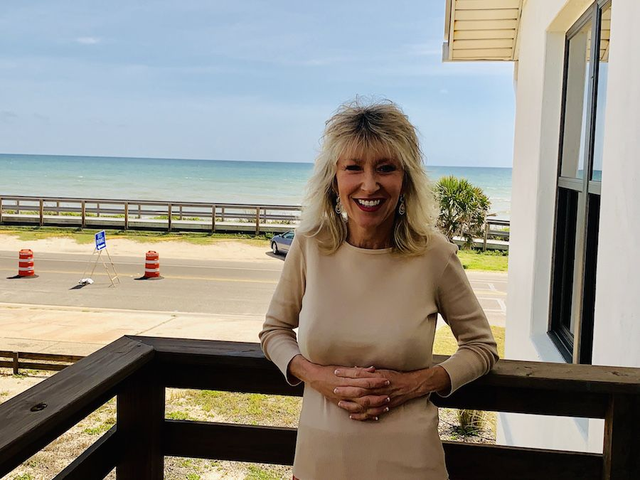Cindy Dalecki on the deck at M2G's Flagler Beach office overlooking the ocean.