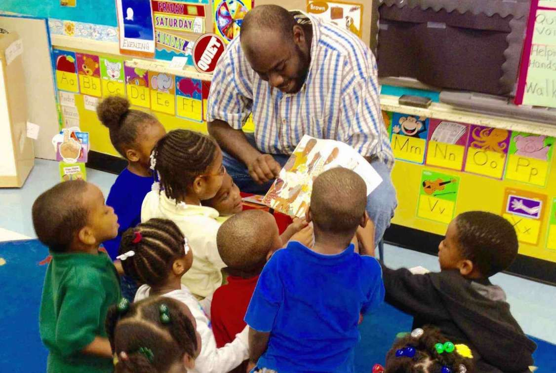 Proud Dad reading to a class on Fathers in Education Day