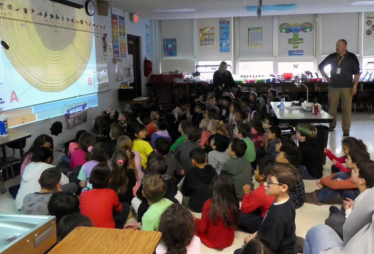 Jeff MacDougall teaches students about trees and recycling.