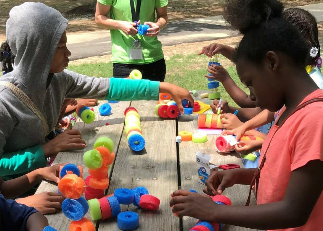 Children make craft projects during summer meals program